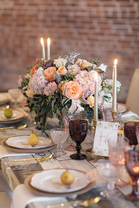 Orange-county-whimsical-wedding-at-franciscan-gardens-table-set-up-with-flowers